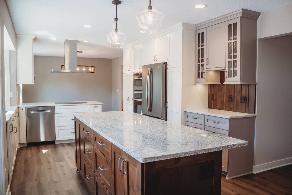 Kitchen Remodel with stained island and white cabinetry